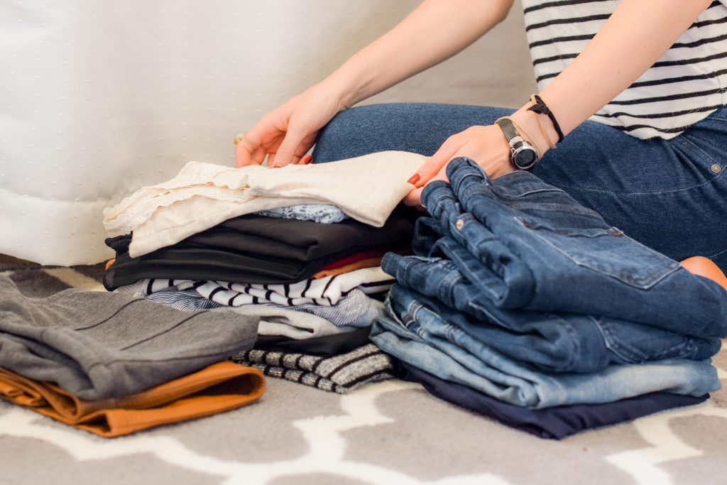 Piles of clothes for decluttering